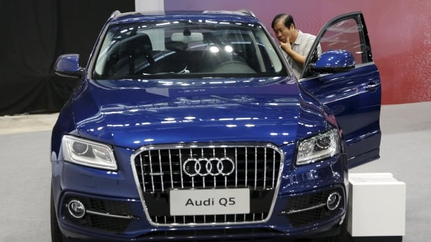 A visitor inspects an Audi Q5 model during the Imported Auto Expo in Beijing, China, on Sept. 24, 2015.