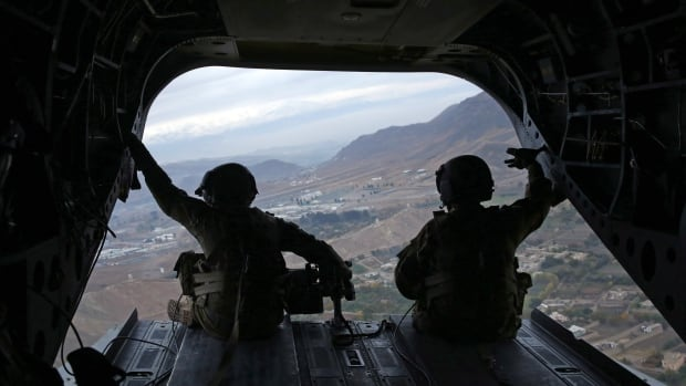 U.S. special forces personnel sit in a military helicopter over Kabul, Afghanistan, in November 2014. CBC News has learned that the Canadian military has been working on a plan to create an integrated force with the U.S.