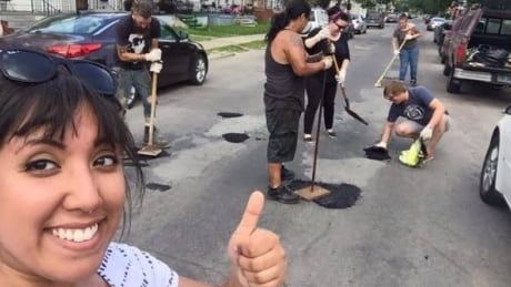 'Guerrilla' road crew busy patching Detroit-area pot holes