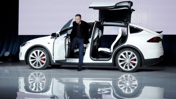 Elon Musk, CEO of Tesla Motors Inc., introduces the Model X car at the company's headquarters on Sept. 29, 2015, in Fremont, Calif. Tesla says it sold 208 Model X vehicles in the final quarter of 2015.