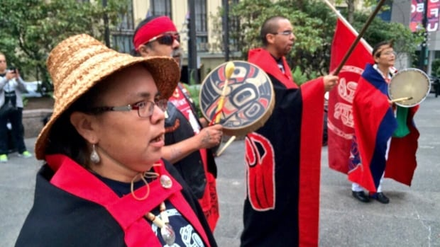 First Nations groups drum in a circle to protest the Northern Gateway pipeline on first day of a court 'mega-hearing' where opponents will get their say.