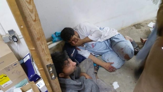 Injured Médecins Sans Frontières (Doctors Without Borders) staff are seen after an explosion near their hospital in the northern Afghan city of Kunduz on Saturday.