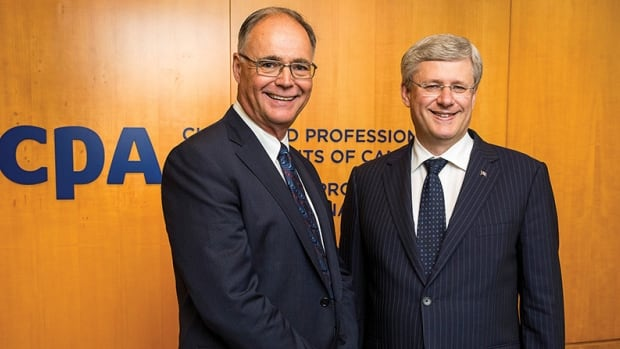 Kevin Dancey, president of the Chartered Professional Accountants of Canada, left, signed a deal with Prime Minister Stephen Harper's government in November under which the industry group will have input into any changes in the Canadian tax system. At the same time, CPA Canada was seeking to battle the CRA in court to shield information about wealthy Canadians with money in an offshore tax haven.