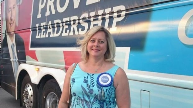 Toronto Conservative candidate Sabrina Zuniga poses in front of a Conservative campaign bus. Zuniga is being mocked for saying that the ground will absorb oil spills.