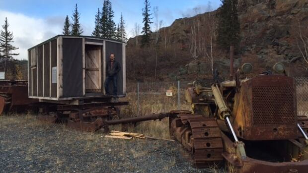 Ryan Silke stands with the caboose of a cat train he helped to restore. 'The men who pioneered this method of transport were hardy, good natured and hard drinkers, accepting the cold and other hazards as everyday occurrences,' says the N.W.T. Mining Heritage Society.