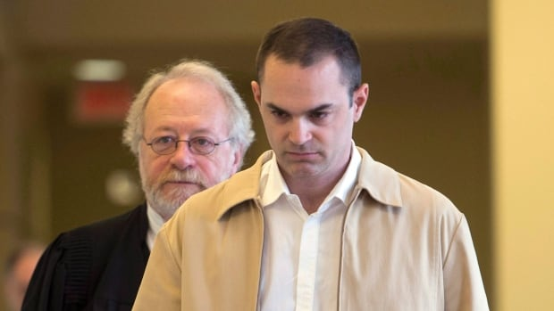 Guy Turcotte, righy, has been tried twice for the murder of his two children.