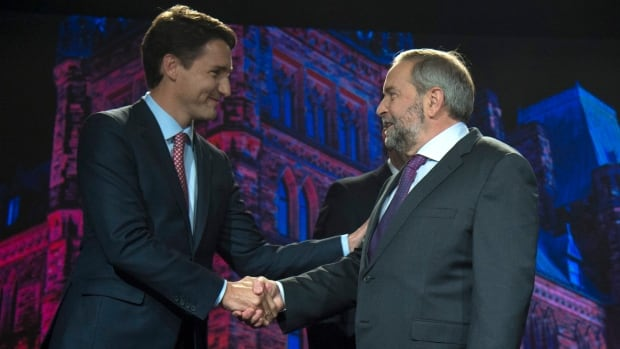 Liberal Leader Justin Trudeau shakes hands with NDP Leader Tom Mulcair prior to the Globe and Mail leaders' debate in Calgary on Sept, 17. The urge to get rid of Stephen Harper is something they can agree on.