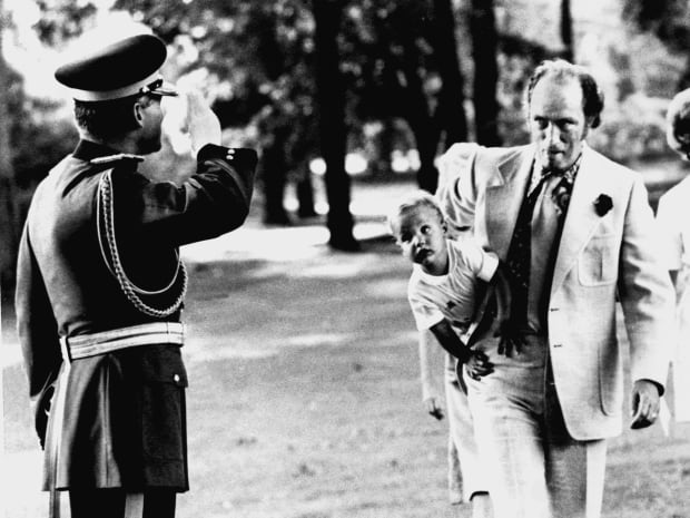 Justin was often in the public eye as he got older, photographed with his famous father. Here, Prime Minister Pierre Elliott Trudeau carries his son past a saluting guard at a Government House garden party in Ottawa, on Aug 10, 1973.
