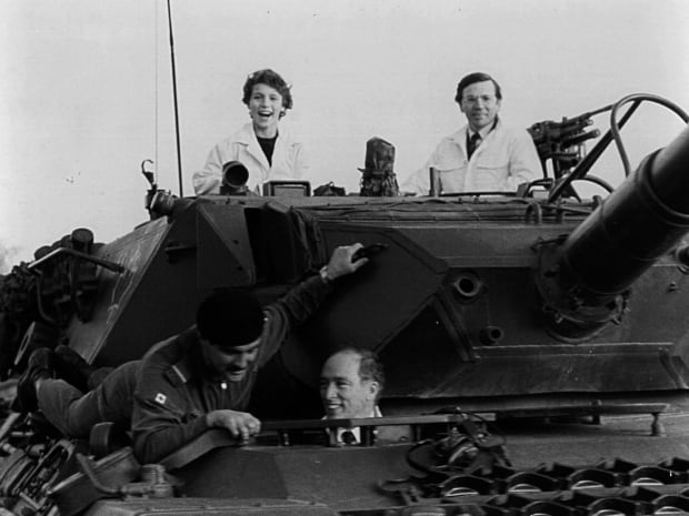 Prime Minister Pierre Trudeau, bottom centre and son Justin, top left, ride a Leopard tank in Lahr, West Germany, on Nov. 11, 1982, along with Canadian Lt. Jon MacIntyre of Charlottetown (bottom left) and Toronto MP Roy McLaren (top right).