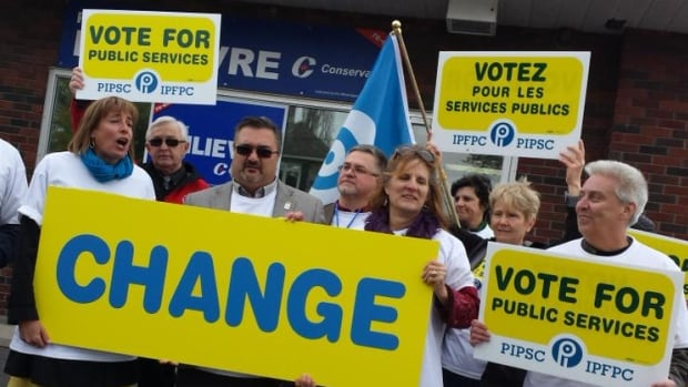 Members of PIPSC, including president Debi Daviau (left) held a photo op, marched to Pierre Poilievre's office and went door knocking in the riding of Carleton Wednesday, hoping to convince people not to vote for the Conservatives in the federal election.