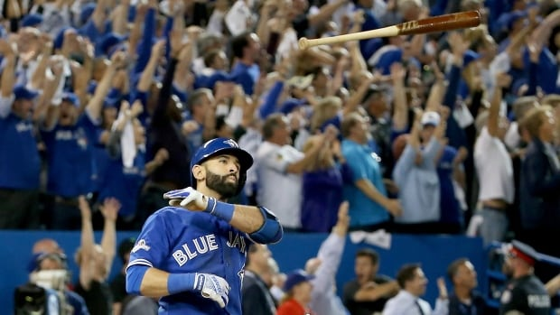 Jose Bautista launches his bat after belting a game-winning home run in Game 5 of the American League Division Series.
