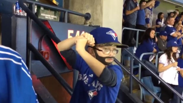 Mini Bautista sets up his swing moments before Jose Bautista knocked it out of the park.