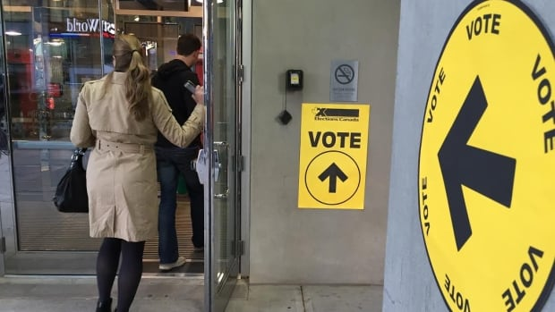 Voters head in to cast a ballot at the University of Calgary's downtown campus in the Calgary Centre riding during the 2015 federal election.