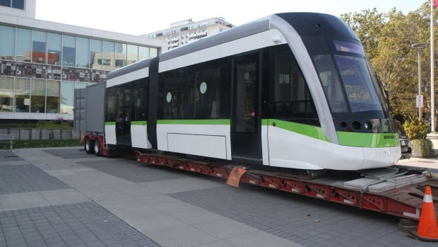 A new light rapid transit car sits in front of city hall late last year. The city will soon clear its first legal hurdle when it comes to LRT - a memorandum of agreement with Metrolinx.