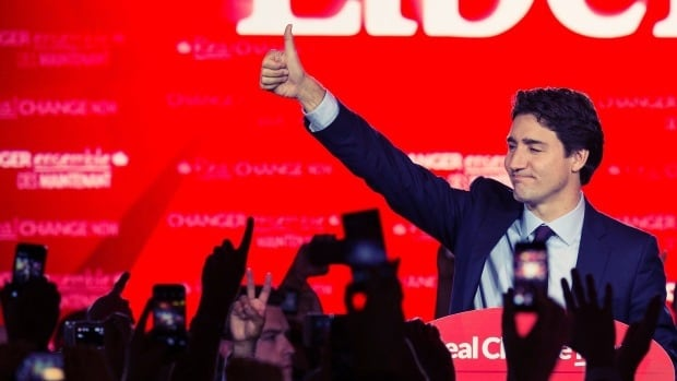 Canadian Liberal Party leader Justin Trudeau waves on stage in Montreal on October 20, 2015 after winning the federal election.