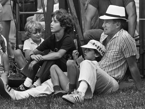 Prime Minister Pierre Trudeau took his three sons to watch the Canada Day ceremonies on Parliament Hill in 1983.
