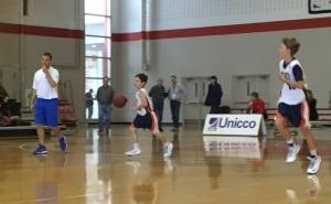 Derek Firth (left), coaches his son's basketball team