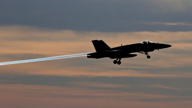 A pilot takes off during the departure of CF-18 Hornets  in Cold Lake, Alberta on Tuesday October 21, 2014.