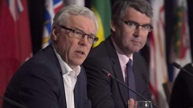Manitoba Premier Greg Selinger speaks as Nova Scotia Premier Stephen McNeil, right, looks on at a news conference during a meeting of Canada's premiers in St. John's, N.L., in July. Premiers are scheduled to gather again today to meet with Prime Minister Justin Trudeau.
