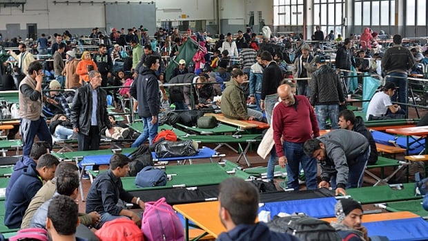 Refugees wait in a crowded migrant registration centre in Passau, southern Germany. Trying to document the continued inflow of asylum seekers has proved overwhelming for German authorities.