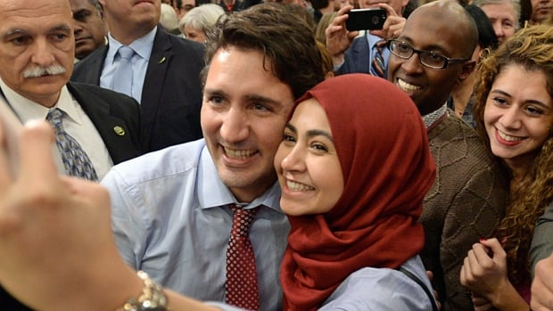 Prime minister-designate Justin Trudeau poses for a selfie with a supporter as he takes part in a welcome rally in Ottawa on Tuesday. Young voters were drawn to a post-baby boom leader.