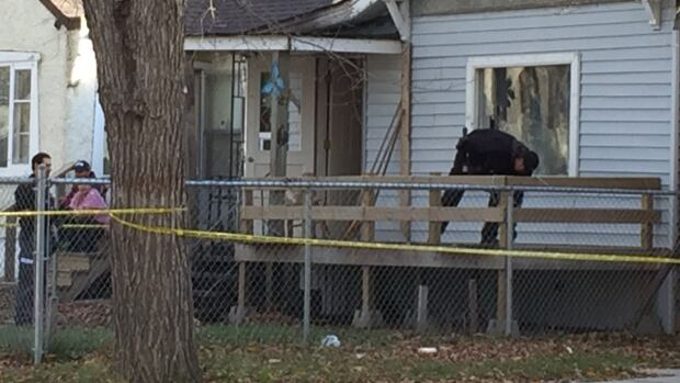 Police investigators were at a home on the 1500 block of Robinson St. in October 2015 after the body of Matthew John Wells was discovered. Three people have now been charged with murder.