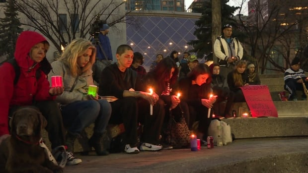 Friends and family of  Christa Cachene, who was found dead in a Calgary house in October, hold a vigil in her memory and to protest violence against women. Police believe Cachene died 'as a result of a vicious beating.'