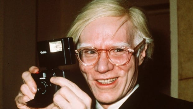 Pop artist Andy Warhol, shown in 1976 in New York, was fascinated by celebrity and fame from his childhood until his death.