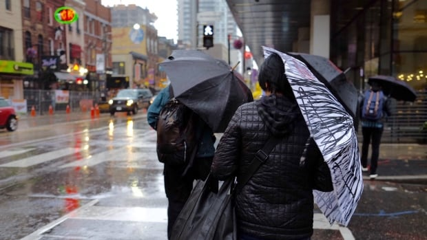 Heavy rain, brought by the remnants of Hurricane Patricia, made for a dark and rainy commute Wednesday morning in Toronto, during which a dozen pedestrians were struck by vehicles.