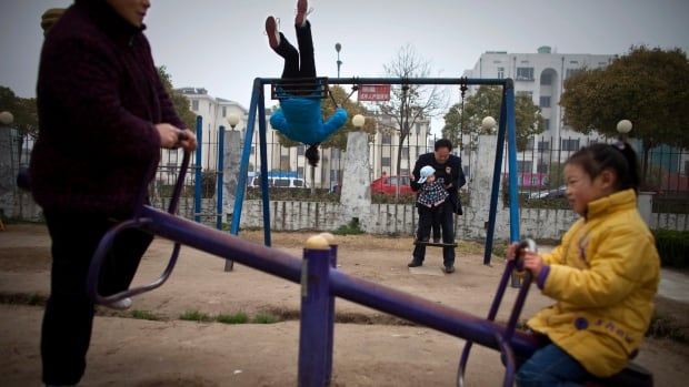 Chinese grandparents and grandchildren play in a park in Dafeng, in east China's Jiangsu province, in this April 2010 photo.  China's ruling Communist Party announced Thursday  it will abolish the country's decades-old one-child policy and allow all couples to have two children, removing remaining restrictions that limited many urban couples to only one.