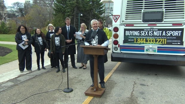Attorney General Gord Mackintosh speaks at the launch of the Buying Sex is Not a Sport public awareness campaign outside the Manitoba legislature in Winnipeg on Thursday.