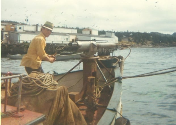 Vaughan George aboard his father's boat