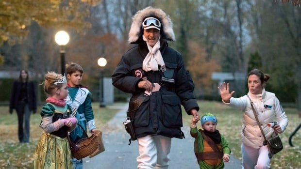 Prime Minister-designate Justin Trudeau, dressed as Han Solo from The Empire Strikes Back, walks with his children Hadrien (second from right), Ella-Grace and Xavier, as his wife Sophie Gregoire, dressed as Princess Leia, jokes with onlookers as the family prepares to go trick-or-treating in Ottawa on Saturday.
