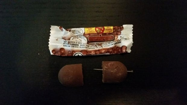 Jennifer Tichborne's daughter found a chocolate bar she collected while trick-or-treating on Saturday night had a needle poking out of it.