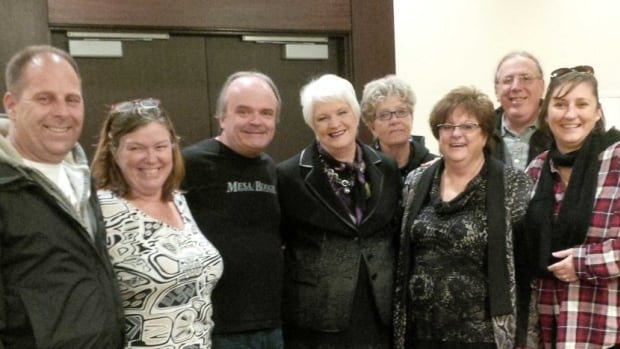 Ontario Education Minister Liz Sandals stands with CUPE members shortly after a tentative agreement was reached with the union, which represents about 55,000 education support workers.