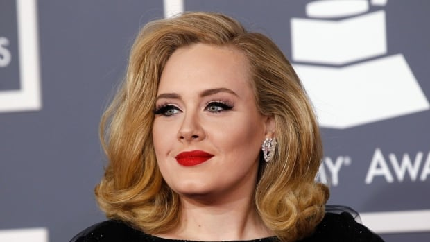 British singer Adele, seen at the 2012 Grammy Awards, has chosen not to offer her new album via music streaming services like Spotify upon its initial release.