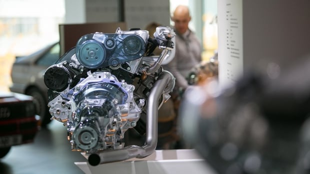 An Audi TDI engine, manufactured by Volkswagen AG, sits on display at the Audi AG headquarters in Ingolstadt, Germany. The Federal Trade Commission is the latest U.S. agency to sue Volkswagen, over its ads for 'clean diesel.'