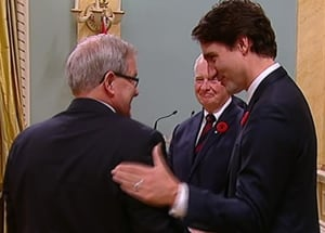 Justin Trudeau shakes Lawrence MacAualay's hand