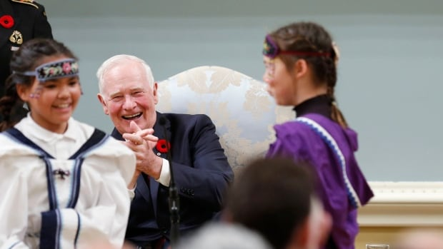 Governor General David Johnston enjoys indigenous children performing during the new government's swearing-in ceremony in Ottawa on Nov. 4.