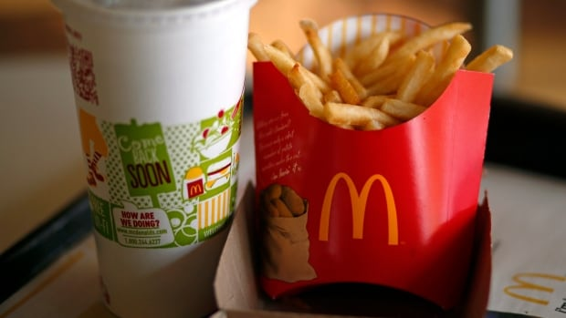 In this Tuesday, Jan. 21, 2014, photo, a large order of French Fries and  drink are photographed at a McDonald's restaurant in Robinson Township, Pa.