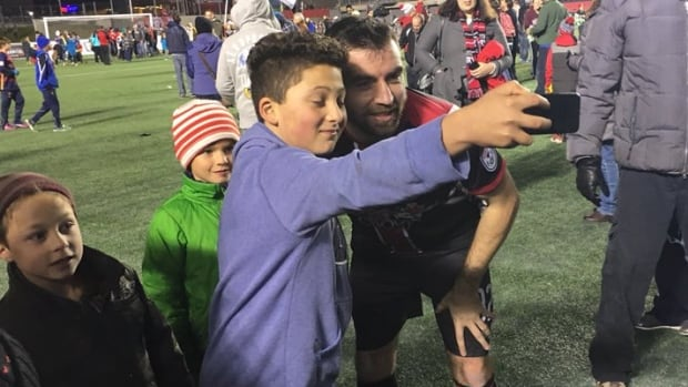 The Ottawa Fury celebrate with their fans after beating Minnesota 2-1 in extra time on Sunday, Nov. 8, 2015. Ottawa won its last home game of the season and will play the New York Cosmos on Nov. 15 for the NASL championship.