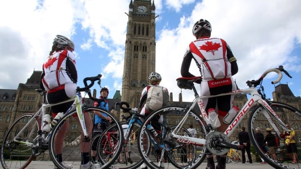 Cycling enthusiasts gather on Parliament Hill in Ottawa to promote bike-friendly infrastructure as a national issue on June 3, 2013.