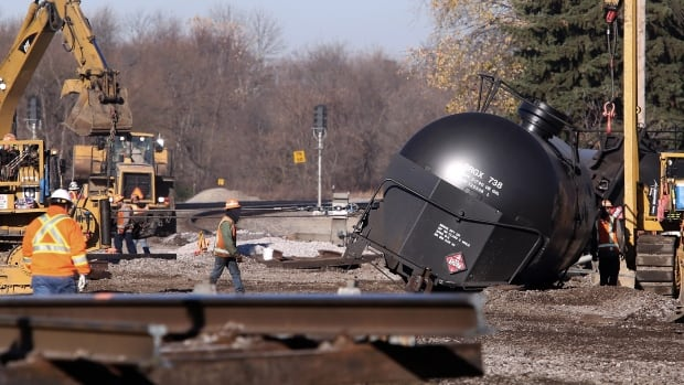 Workers tend to the scene of a train derailment in Watertown, Wis., on Nov. 9, 2015, after a 13 cars of a Canadian Pacific train carrying crude oil overturned Sunday.