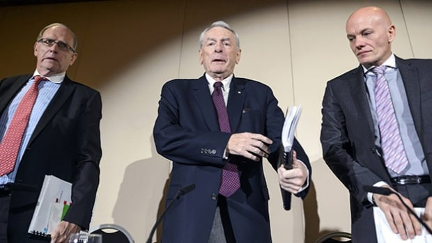 Commission chairman Dick Pound, centre, and panel members Richard McLaren, left, and Guenter Younger presented their findings Monday in Geneva on allegations of widespread doping and deception involving Russian track and field athletes.