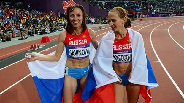Photo: Russia's Mariya Savinova, left, and Ekaterina Poistogova won gold and bronze, respectively, at the 2012 London Olympics were accused of doping (Franck Fife/AFP/GettyImages)