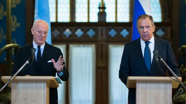 In this Wednesday, Nov. 4, 2015, file photo, Russian Foreign Minister Sergey Lavrov, right, listens as UN Special Envoy for Syria Staffan de Mistura speak during a news conference following their talks in Moscow.