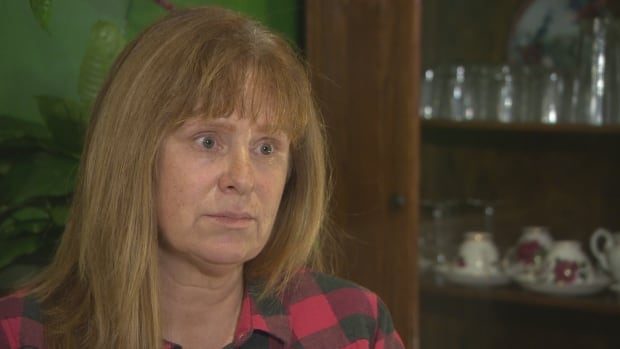 53-year-old Catherine Burden says selling her family's house might be the only way to get out of debt.