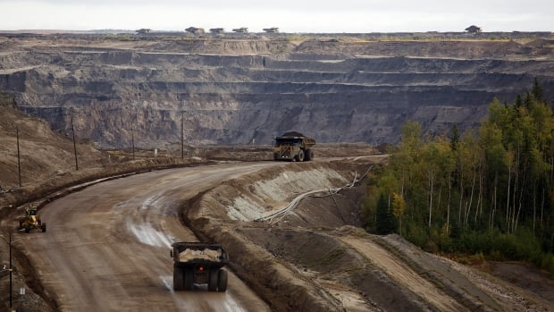 "Giant dump trucks haul raw material at the Suncor oilsands mining operation near Fort McMurray in 2014, when times were better. In 2016, the Conference Board of Canada predicts ""the rout on crude oil markets will continue to hammer Alberta's economy."""