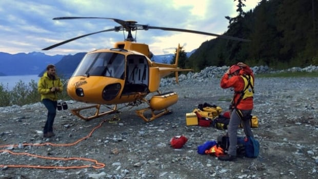North Shore Rescue volunteers gear up for a helicopter rescue, near The Lions, north of Vancouver.