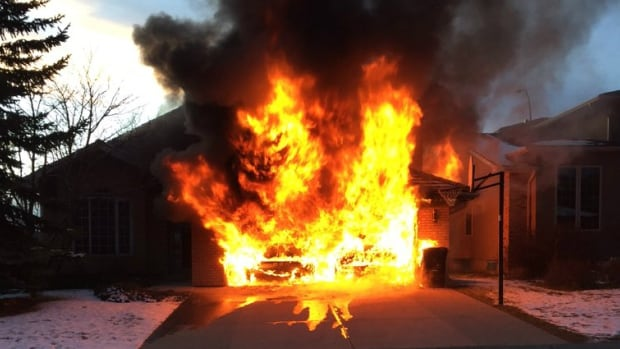 A neighbour took this photo of a fire at a house in Christie Park Thursday afternoon.